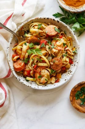 Chicken Jambalaya and Shrimp Jambalaya pasta inside of a white bowl against white background #jambalaya #pasta #cajun