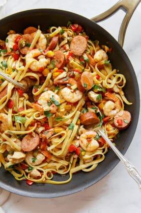 An overhead shot of a skillet filled with cajun jambalaya pasta recipe with shrimp and sausage #jambalaya #pasta #cajun