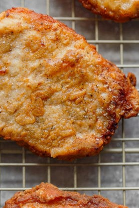Close Up of Southern Fried Pork Chops recipe draining on rack after learning how to cook pork chops on the stove