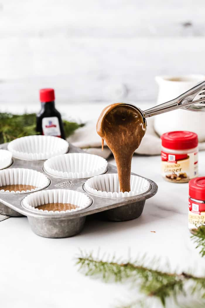 Pouring of Gingerbread cupcake batter into cupcake liners