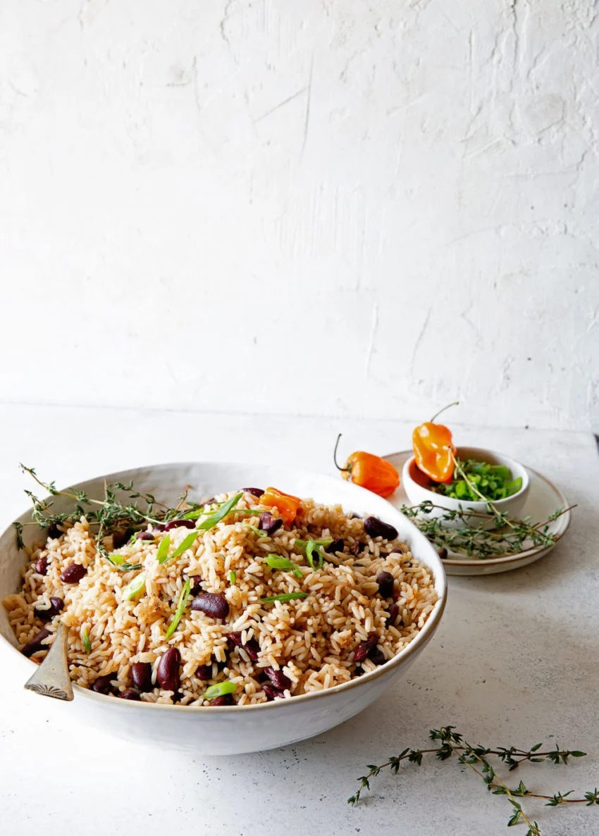 Jamaican Rice and Peas in white bowl against white wall