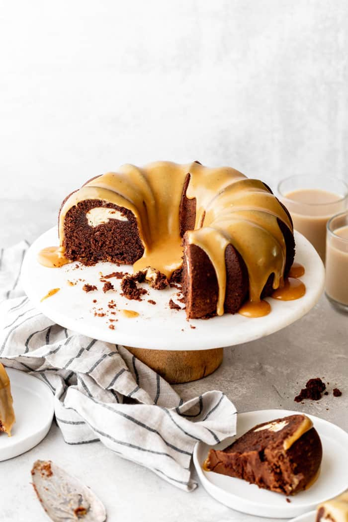 Beautiful chocolate bundt cake with white chocolate ganache glaze