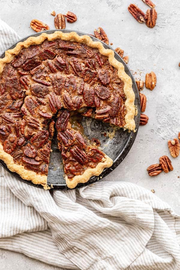 A freshly baked pecan pie with slices ready to serve