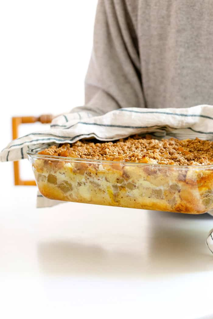 A woman holding Apple Crisp French Toast recipe ready to serve