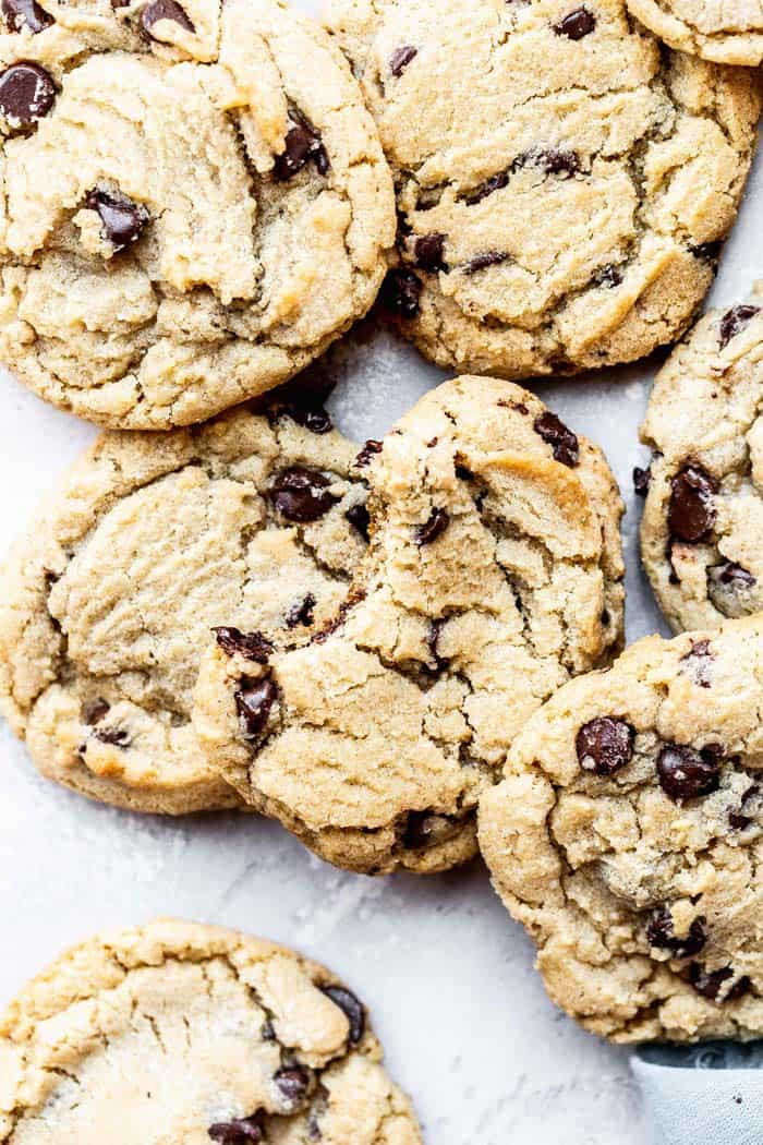 Gluten Free Chocolate Chip Cookies ready to eat scattered around in a kitchen