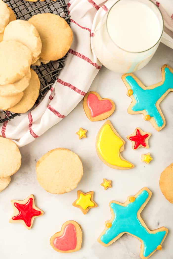 An overhead of iced sugar cookies in amazing shapes with round cookies