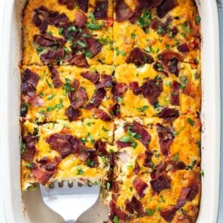 Breakfast bake recipe is cut into squares with a spatula ready to serve for brunch