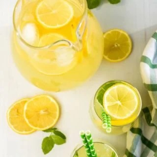 Southern lemonade in pitcher with glasses filled ready to serve