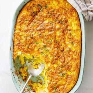 Baked corn spoonbread being served during a meal