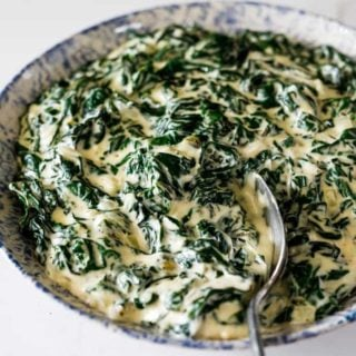A delicious bowl of perfectly creamed spinach ready to serve with dinner