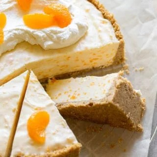 No Bake Orange cheesecake with three slices cut and one leaning on its side