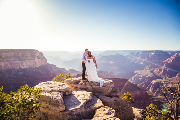 grand canyon wedding bride and groom standing on overlook