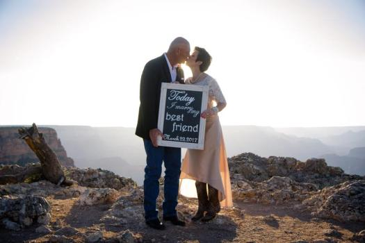 grand canyon wedding bride and groom holding sign