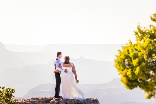 grand canyon wedding bride and groom standing on lipan point