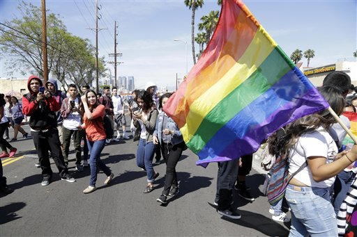 """Students rally outside Santee Education Complex in South Los Angeles on Wednesday, April 20, 2016. The principal of the Los Angeles high school where a scuffle broke out with adult protesters over a new gender-neutral bathroom praised his students Wednesday as """"trailblazers"""" for campaigning to install the restroom. Bathrooms for transgender students have become a focal point in the national debate over anti-discrimination laws. (AP Photo/Nick Ut)"""