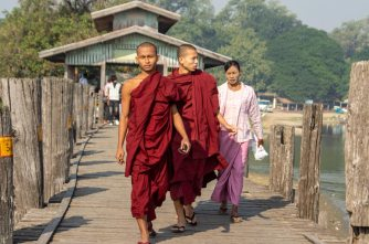 monks on bridge