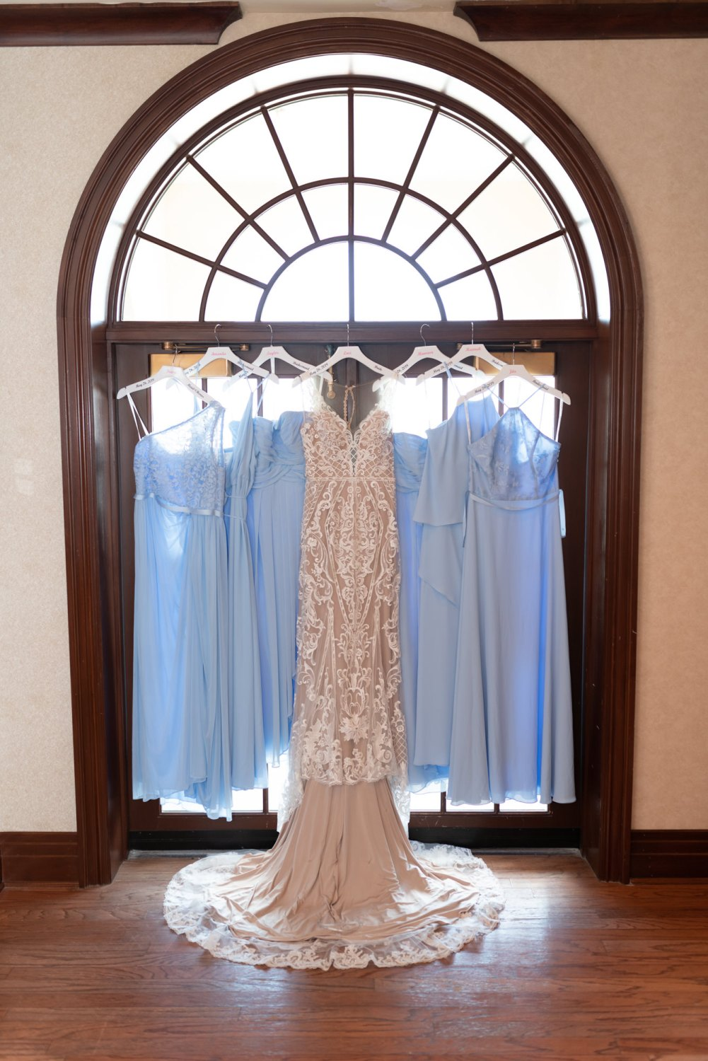 Bride and bridesmaids dressing hanging in windowlight - Grande Dunes Ocean Club - Myrtle Beach