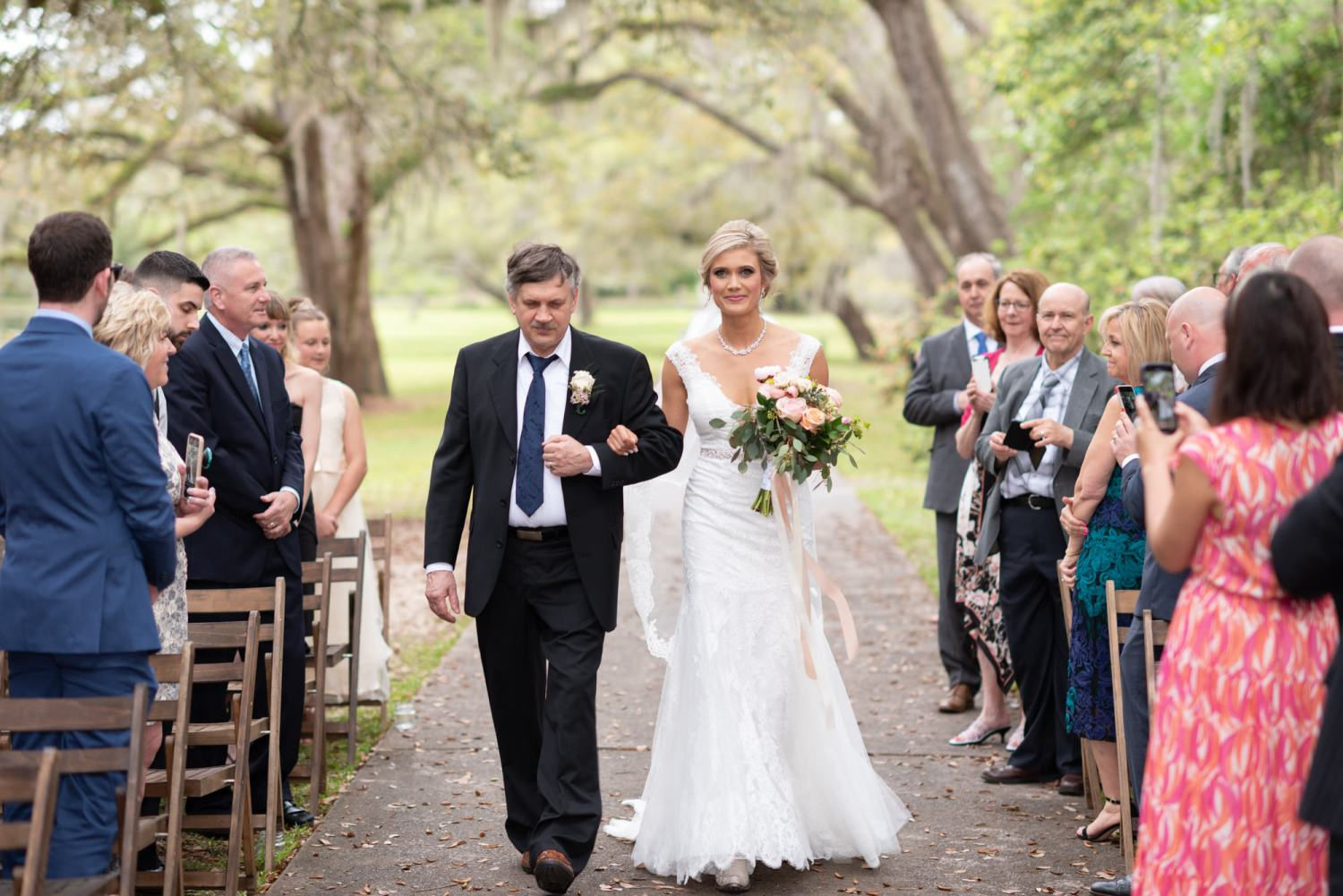 Bride and father walking down the isle - Brookgreen Gardens