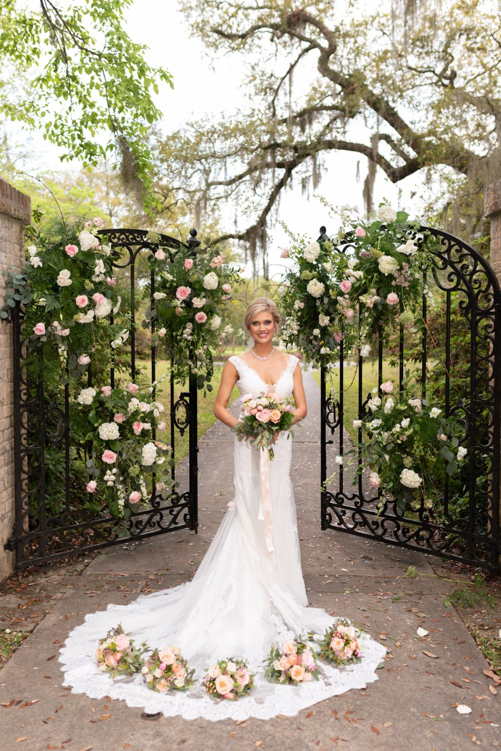 Bride posing in front of the gates - Brookgreen Gardens
