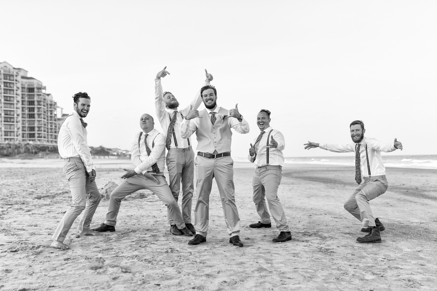 Groom having fun posing with the guys by the ocean - Grande Dunes Ocean Club - Myrtle Beach