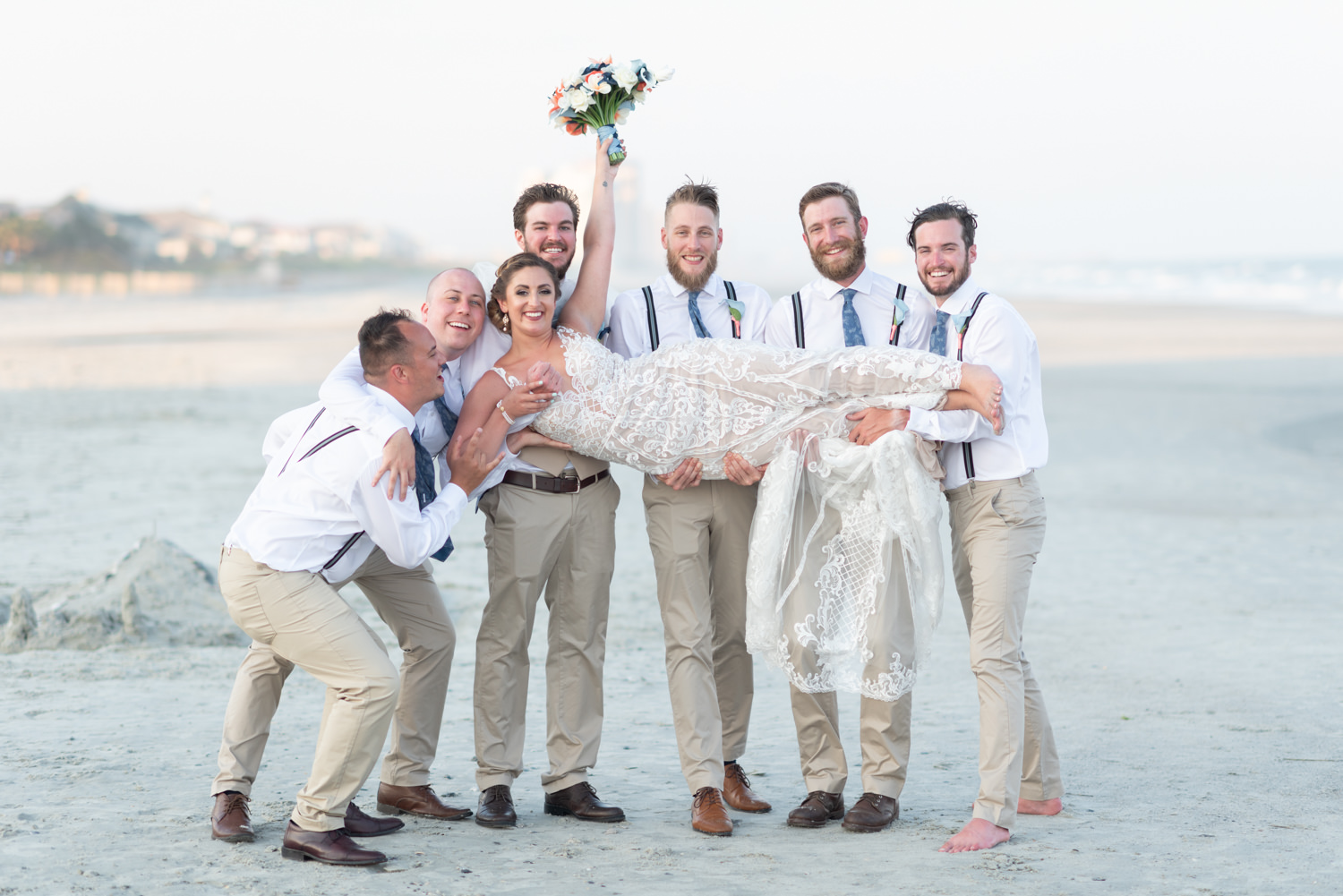 Groomsmen lifting up the bride - Grande Dunes Ocean Club - Myrtle Beach