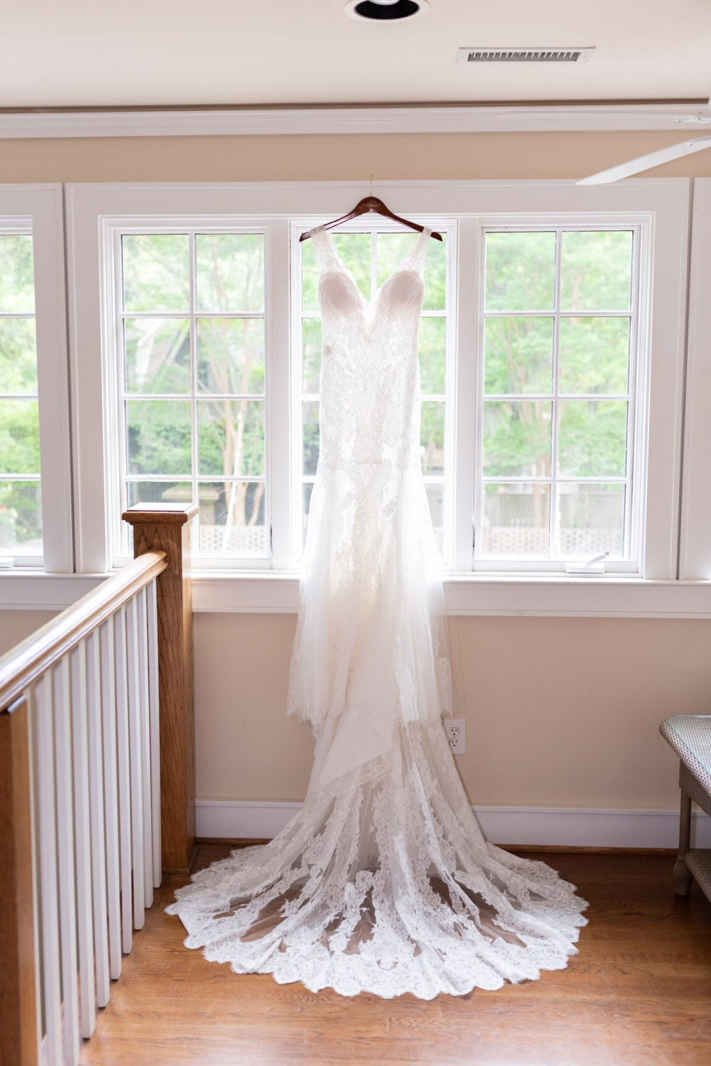 Wedding Dress hanging in the window - Brookgreen Gardens