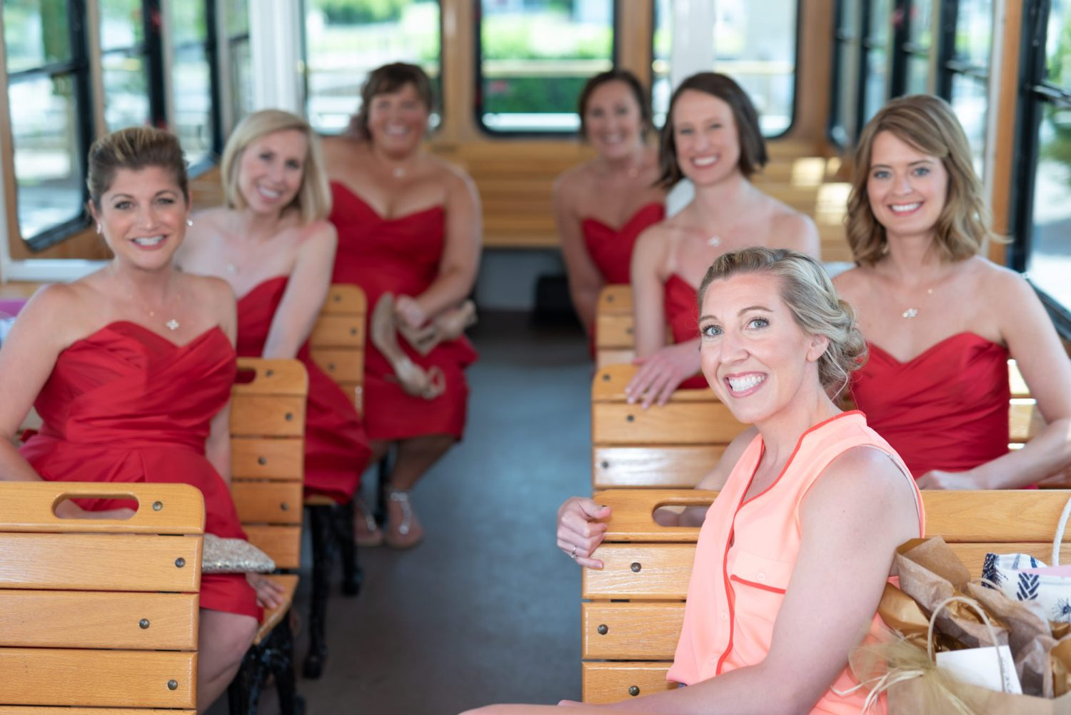 Bridesmaids taking the trolley  - Wachesaw Plantation