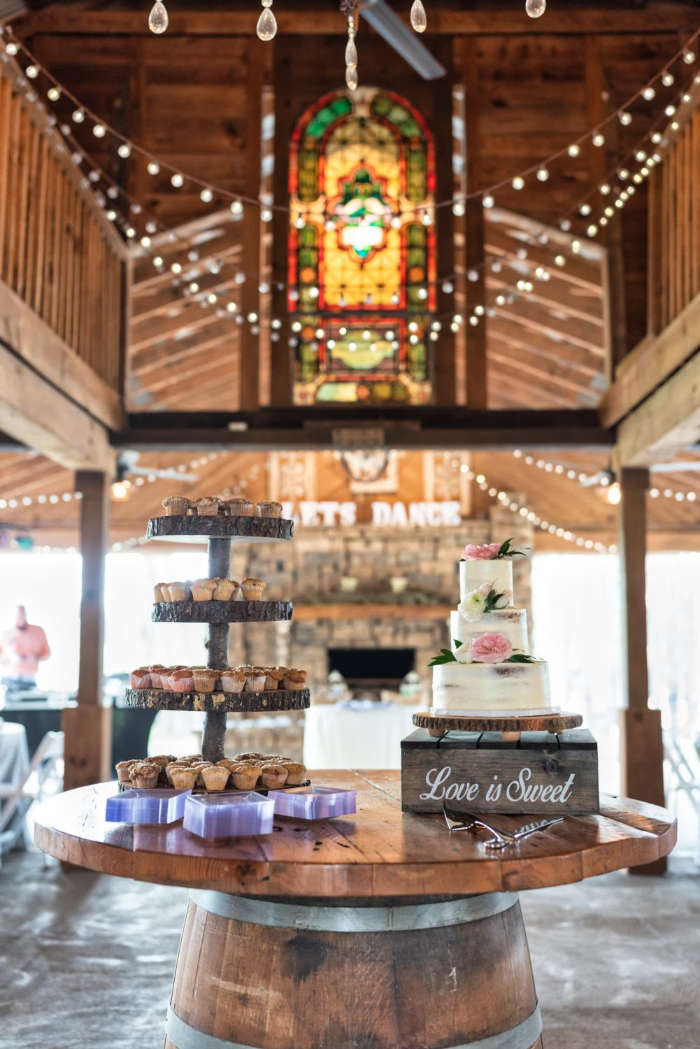 Detail picture of the cake table with stained glass window in the background - Wildhorse at Parker Farms