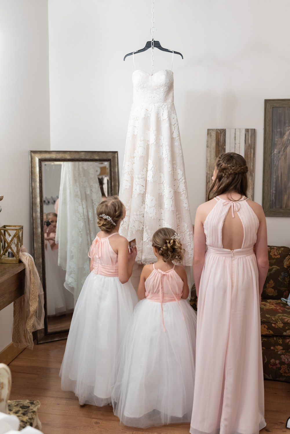 Flowergirls looking at bride's dress - Wildhorse at Parker Farms