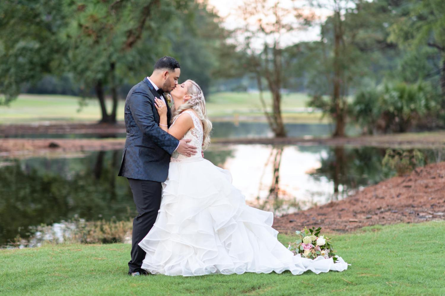 Kiss in front of the golf course lake - Litchfield Country Club
