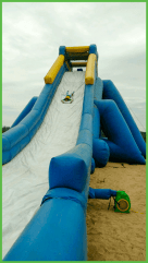 Water Slide with Kid Coming Down Head First