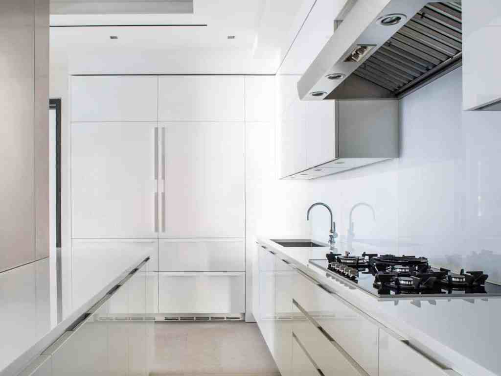 An all-white kitchen with a Nano Crystallized Glass countertop