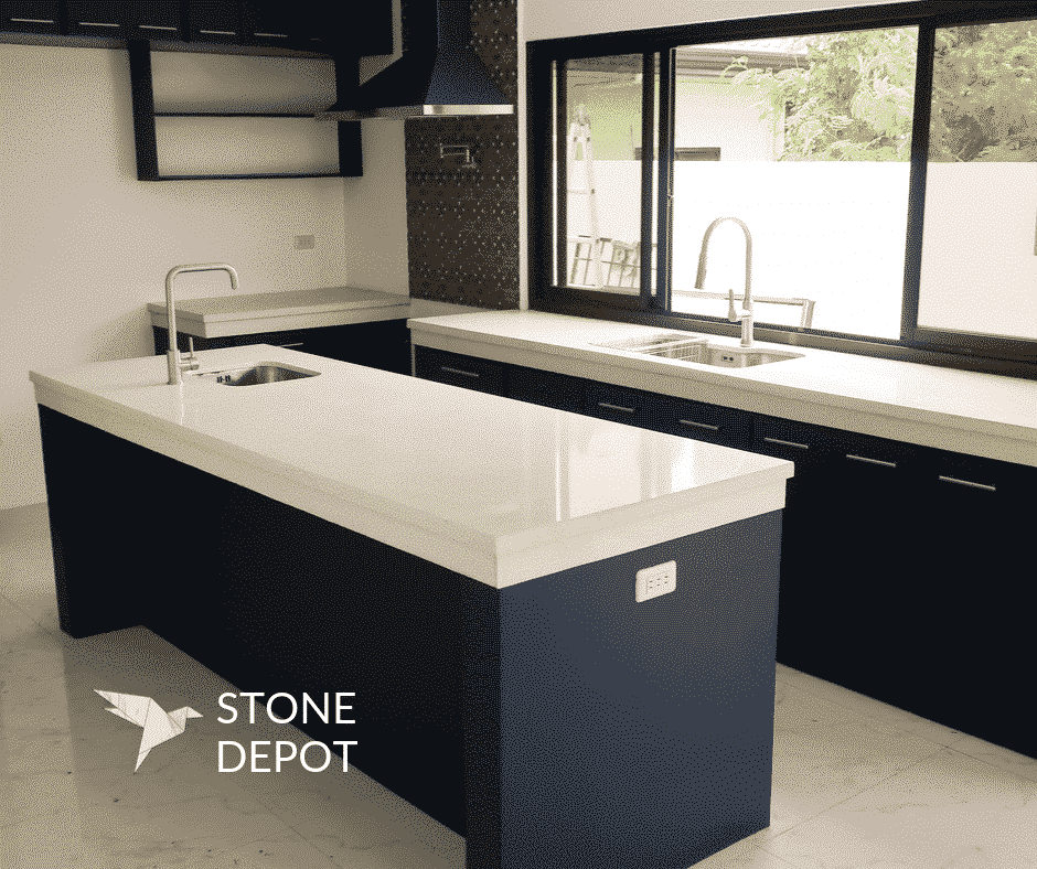 L-shaped white quartz countertop and kitchen island in Lanang, Davao City