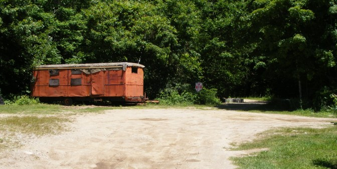 Don't be put off by this beat-up trailer on the fairgrounds; the trailhead is here, with adjacent parking.