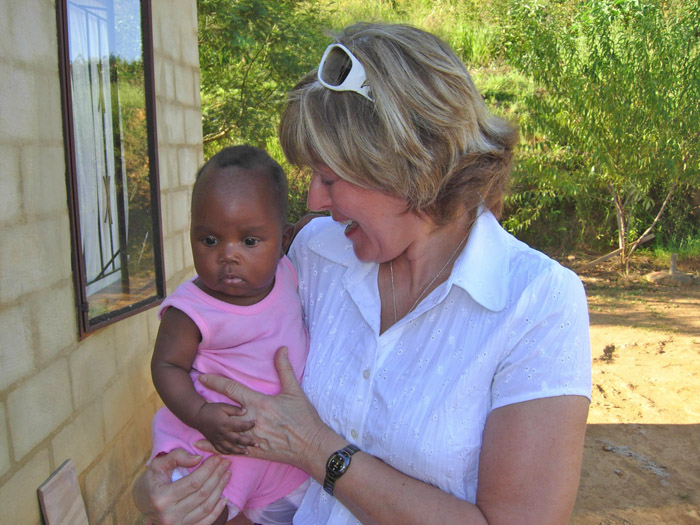 "Susan Fenner hopes to see little Lethabo again, whom she met a year ago. The name Lethabo translates as ""Happiness"", an indication of her young mother's hope for her future"