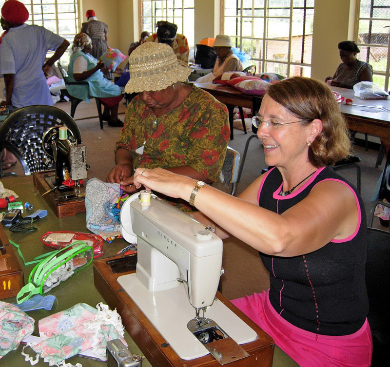 Ubuntu Centre is a hive of activity as African grandmothers busy themselves with hand sewn projects, while Beverley Barling teaches machine skills to Marjani Theledi
