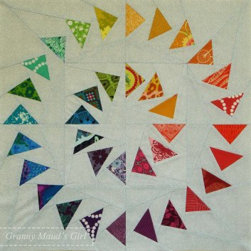 Patchwork circle of geese block with two clockwise circles
