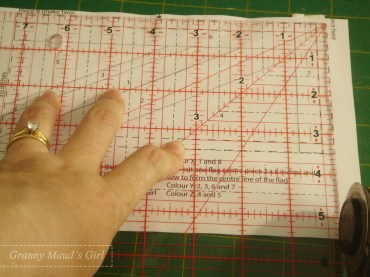 Line up a ruler so it is square with two sides and trim to the outermost dotted line.