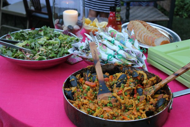 Set a small table in the yard for serving the salad and paella. This makes it easier for guests to go back for seconds, rather than walking back into the kitchen.