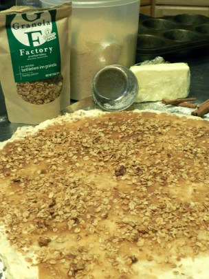 Once the cinnamon sugar is spread on dough, sprinkle with granola.