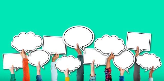 Group of Hands Holding Speech Bubble Concept