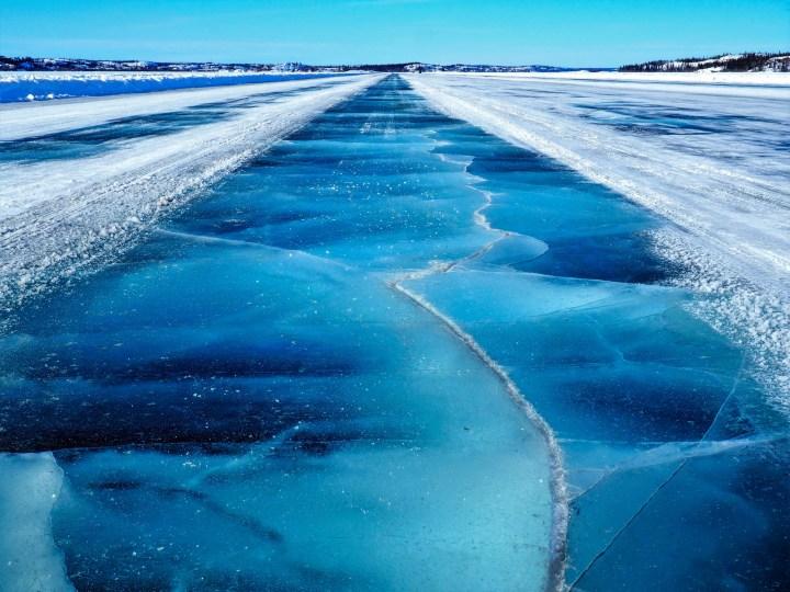 Frozen Cracked Blue Dettah Ice Road showing cracks,