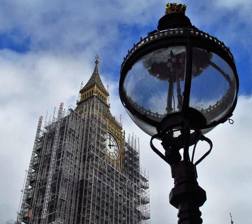 Scaffolding on Big Ben, London, with a view of a lamppost in the foreground