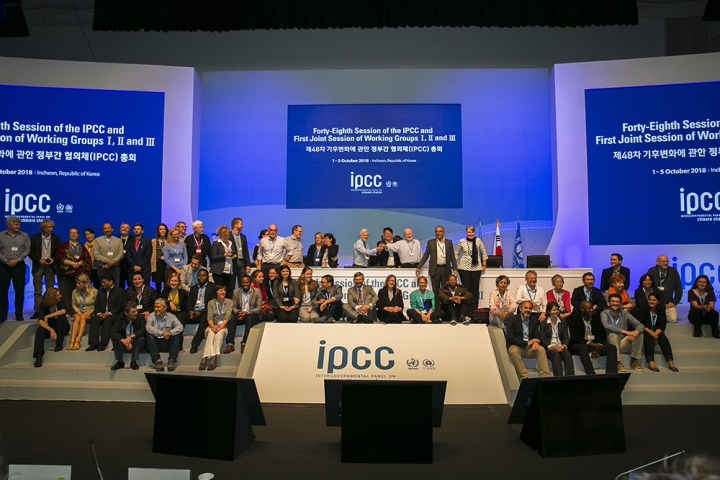 IPCC Special Report authors sitting down behind IPCC branding on the stage at the launch event (c) climate nexus