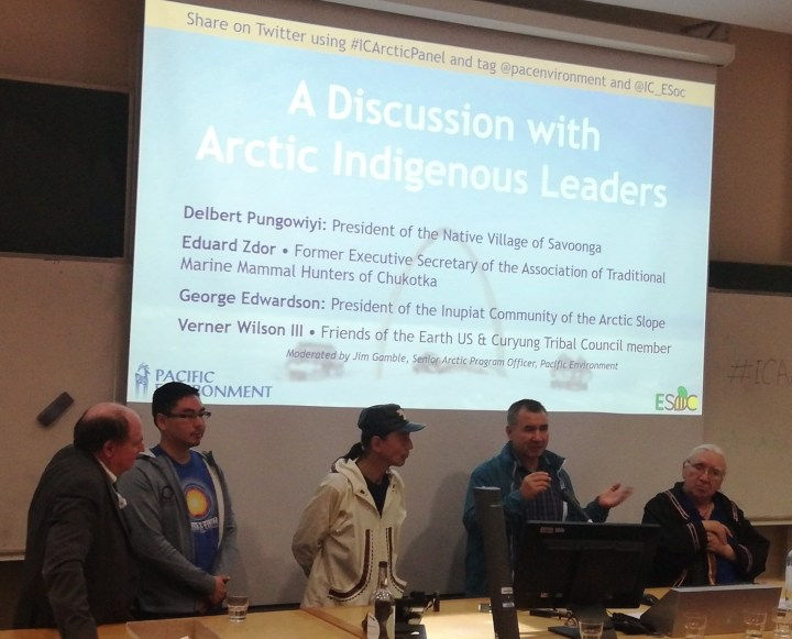 5 Arctic indigenous leaders standing in front of a screen presenting to the audience