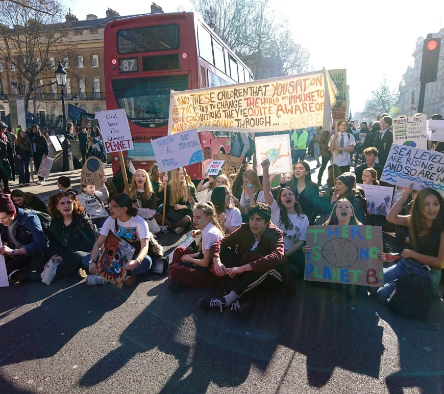 Protesters sitting outside Westminster for the Youth Strike 4 Climate