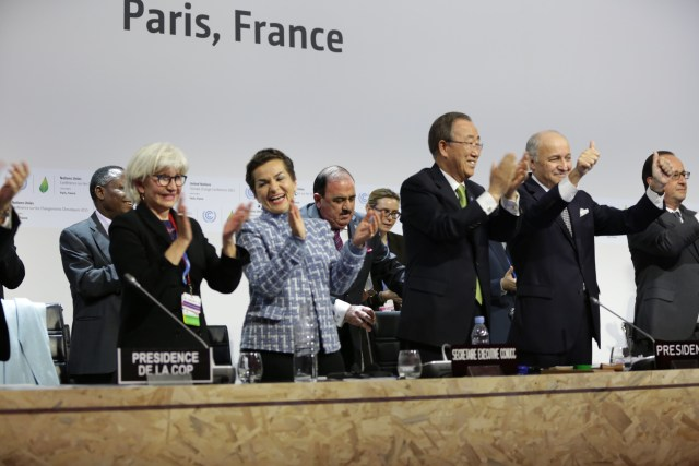 Lead negotiators celebrate the adoption of the Paris Agreement in 2015