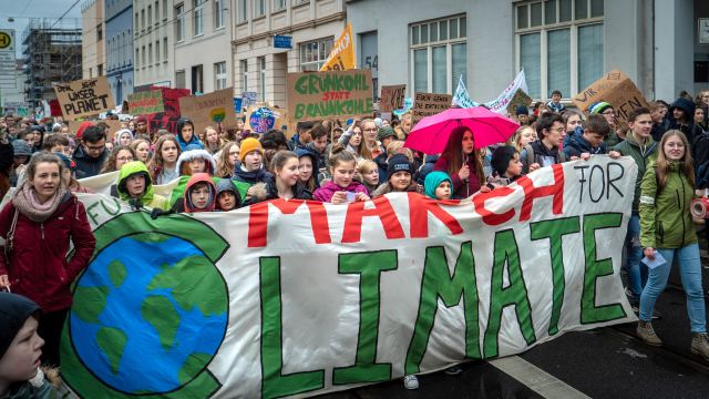 A group of children taking part in a climate march