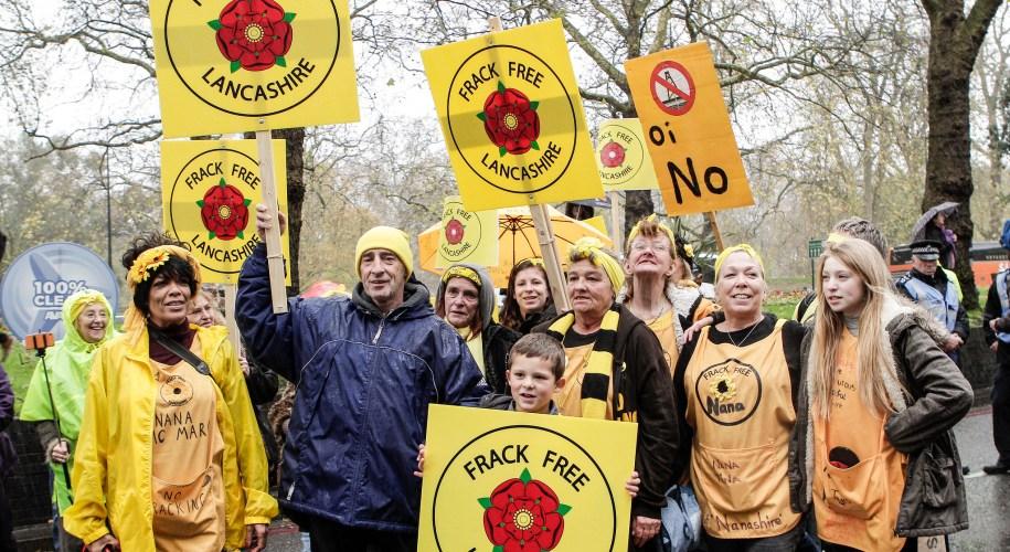 "Anti-fracking protesters with yellow signs saying ""frack free Lancashire"""