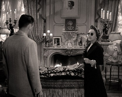 Screen shot From Sunset Boulevard, with artwork prominently displayed above mantle.